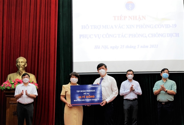 Phenikaa Group donates more than 900000 to COVID-19 vaccine fund