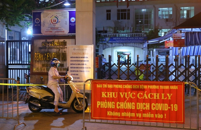 Hà Nội lung hospital locked down after 14 found with COVID-19