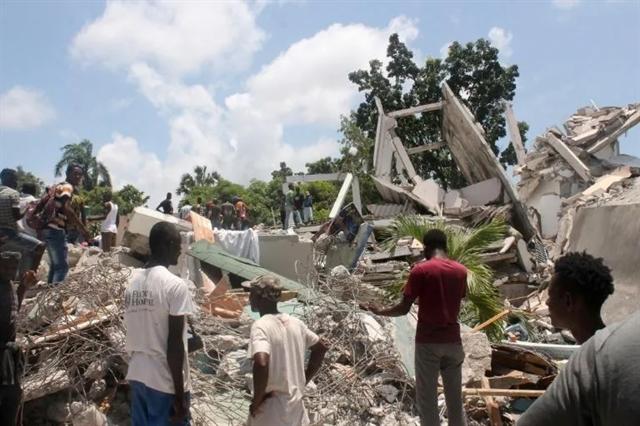 Death toll in massive Haiti quake jumps to over 1200