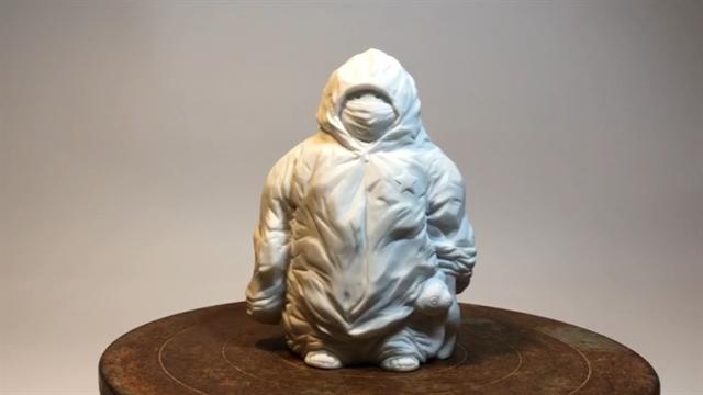 Artist creates statue of children in quarantine