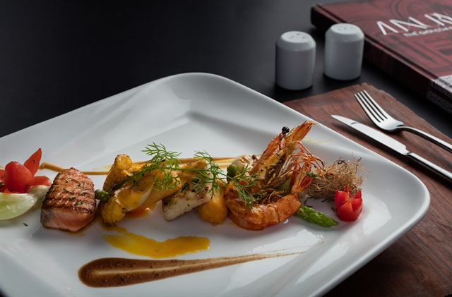 Four-Season Grilled Seafood with Passion Fruit  Mắc KhénSauce