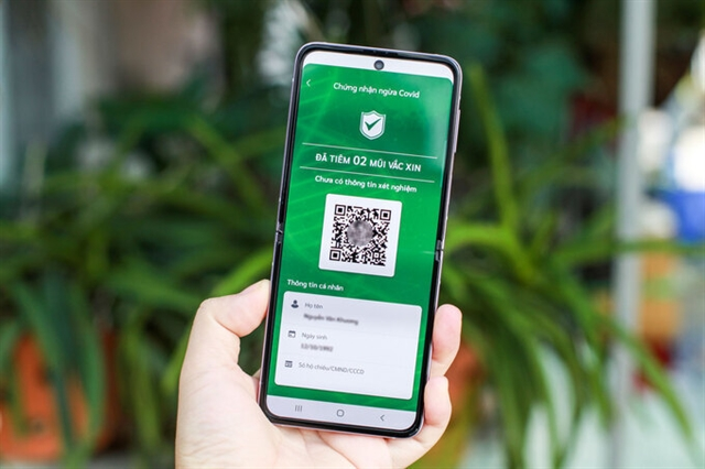 HCM City to pilot COVID green card in districts 7 Cần Giờ Củ Chi