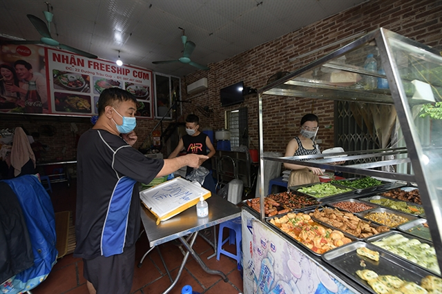 Hà Nội allows reopening of delivery-only food anddrink venues indistricts with no community COVID-19