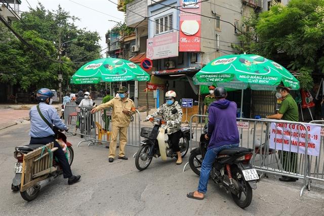 Hà Nội to halt checks on travel permits in COVID-19-free zones