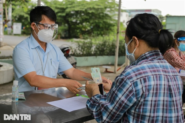 HCM City ready with 3rd COVID relief package for laid-off workers, poor