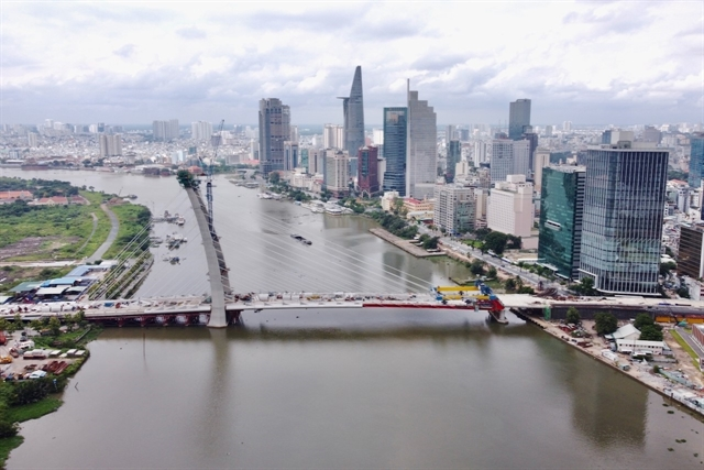 Two sides of downtown HCM City bridge linked up
