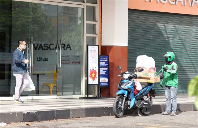 HCM City allows food and drink takeaway services reopens IT stores