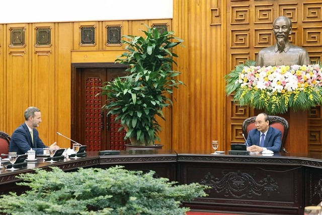 PM Phúc said VN does not devaluate currency urges objective assessment from the US
