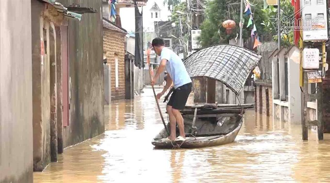 Floods wreak havoc on Hà Nội suburbs