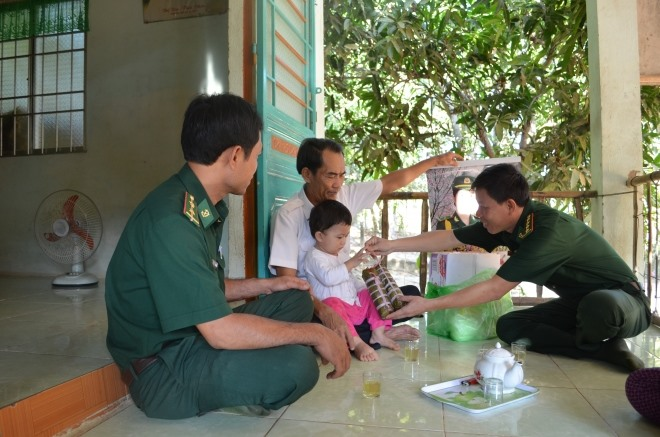 Khmer soldier adopts comrades HIV-infected kid