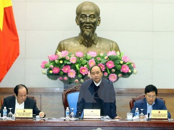PM chairs Việt Nam-Laos co-operation meeting