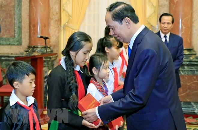President praises disadvantaged students for top grades