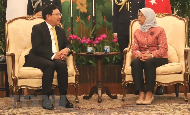 Deputy PM Phạm Bình Minh meets Singaporean leaders