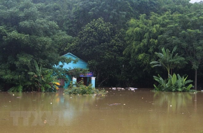 Typhoon Bebinca weakens but leaves villages submerged in water