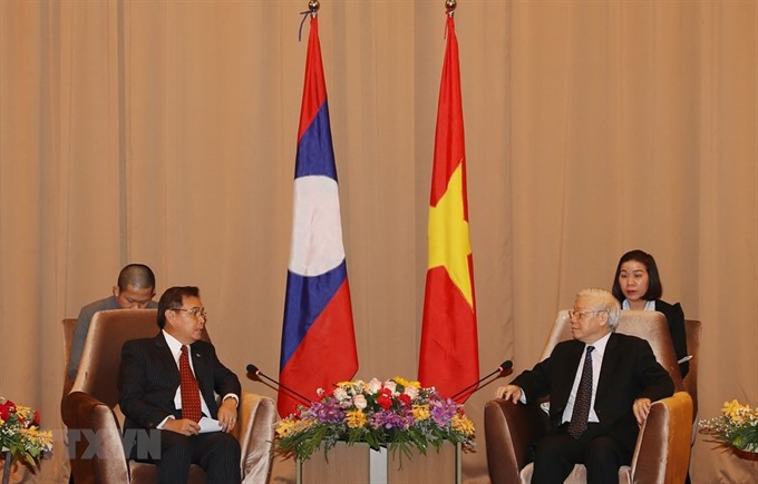 Party State leader lauds joint work between Vietnamese Lao fronts