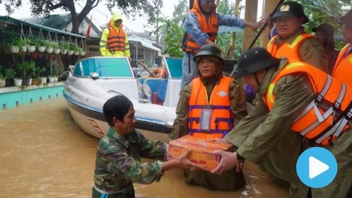 Heavy rain floods wreak havoc in central provinces as new typhoon approaches