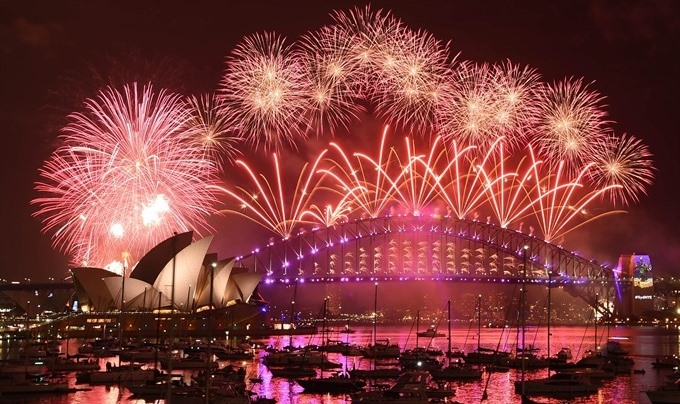 World parties ring in New Year despite terror jitters