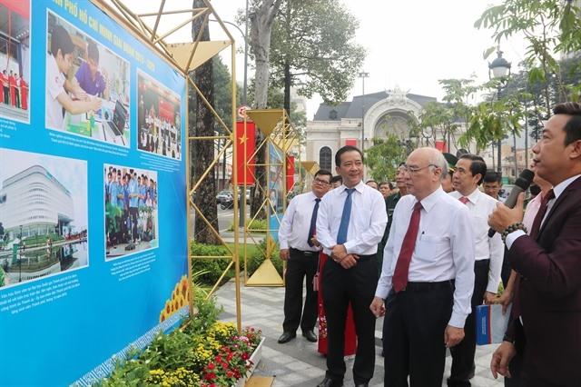 Photo exhibition celebrates HCM City Party Congress