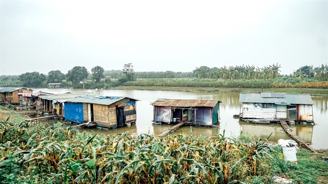 Residents of floating village fear for their future under Red River project