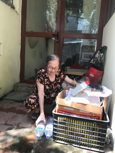 Elderly woman shows trash can mean cash