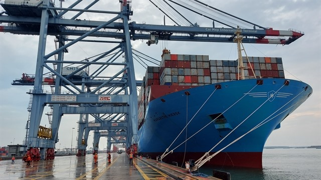 Massive container ship docks at Cái Mép International Terminal