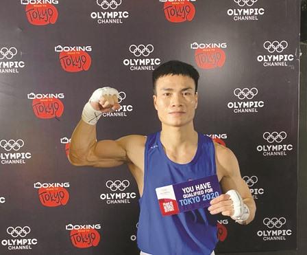 Boxer Đương grabs qualification for Tokyo Olympics