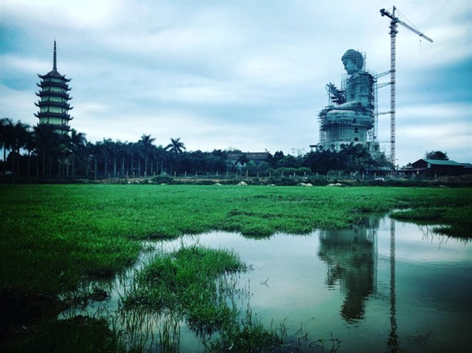 A giant Buddha statue is under construction at the Khai Nguyên Pagoda in Sơn Tây District around 50km from Hà Nội. The 72m high statue is considered as the biggest Buddha statue in Southeast Asia. — VNS Photo Việt Thanh