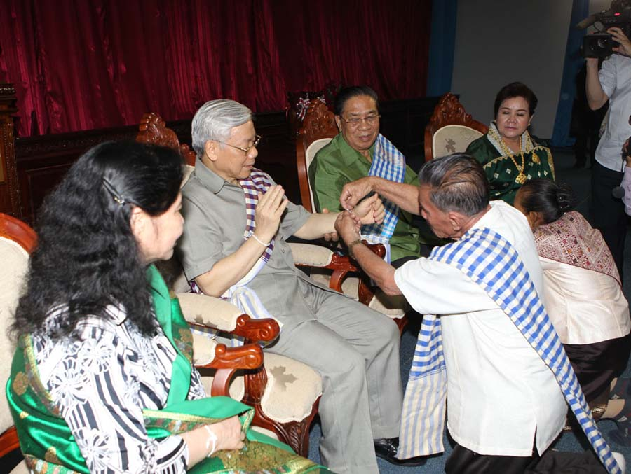 Party leader visits Laos for New Year
