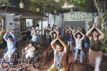 Moving: More than 20 wheelchair users and people with impaired mobility learn the basic movements of cumbia, a Latin dance.