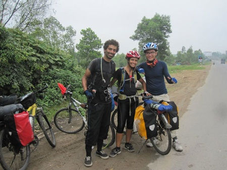 Not a race: Truong Van Phuc (right) takes a photo with a German couple who cycled from India to Singapore.