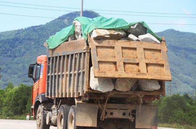 Overloaded mining trucks damage national highway