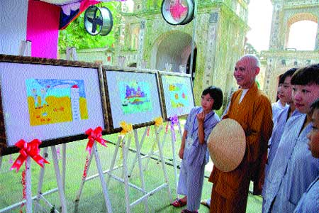 End of term show: Teacher monk Most Venerable Thich Thanh Phuong reviews the final artwork of the youths.