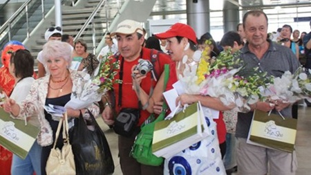 Russians visitors arrive at the Cam Ranh International Airport.