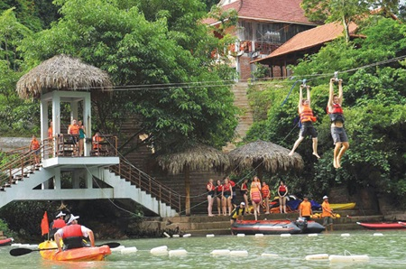 Foreign tourists enjoy activities in the central province of Quang Binh. The number of foreign tourists visiting Viet Nam has grown over the last three months, following a 13-month decline due to disease, unstable economies and fierce regional competition.