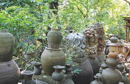 Priceless treasures: Items which have been uncovered by researcher Ho Tan Phan, found in the Huong River bed in Hue.