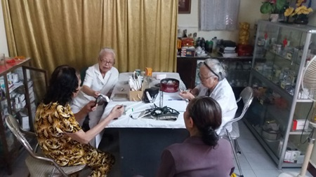 A doctor and a nurse, both retired, have provided free health checks for more than 20 years to patients in Ha Noi.—