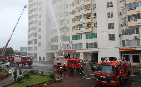 Firefighters practise their skills on a high-rise building in Ha Noi's Cau Giay District. Negligence and ignorance of fire safety regulations by investors and residents at high-rise buildings have come to the public's attention following the latest blaze in Ha Noi.