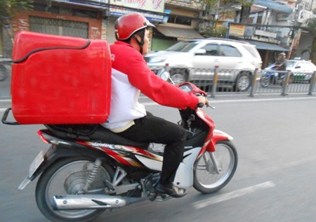 A shipper transports goods to customers in HCM City. A shipper is now considered a hot job for young people and motorbike drivers.