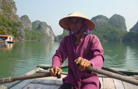 Nguyen Van Vinh works as a boatman, taking tourists to Vung Vieng Village in Ha Long Bay every day. Since local authorities offered the job to relocated residents like Vinh, he says their lives have improved.
