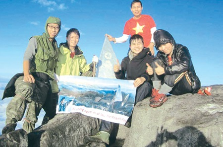 Great heights: A group of young adventures on the Fansipan Peak. Once operational in April 30, a three-rope cable car system will carry passengers from the bottom to the highest point of the mountain.