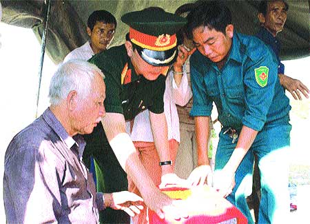 Final farewell: Veteran Nguyen Van Minh (left), with an officer and soldiers from the Binh Thuan provincial military headquarters, works to exhume martyrs' remains and rebury them in their final resting places.