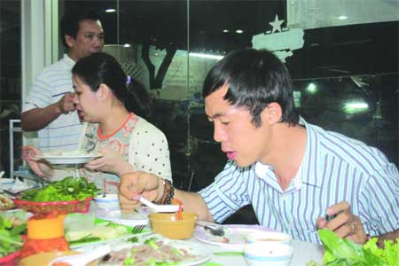 Eating with relish: Vietnamese tourists enjoy a bowl of sweet and sour soup at Jeraporn Restaurant.