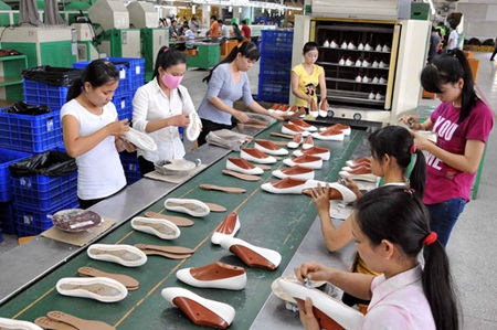 Workers produce shoes for export at My Phong Shoe Company Limited in the southern province of Tra Vinh. Viet Nam is currently the third largest exporter of footwear in the world.