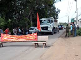 People protest against overloaded quarry trucks